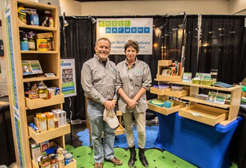 Photo of ShelfHarmony owners at a trade show booth